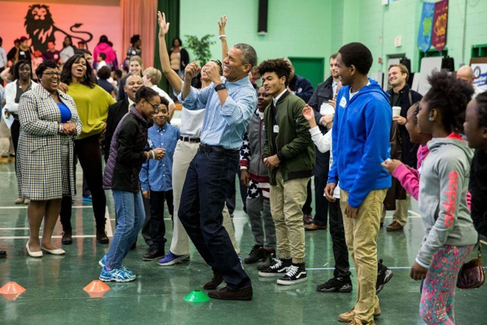 President Barack Obama, with First Lady Michelle Obama, reacts to getting beat at Rock, Paper, Scissors during a Martin Luther King, Jr. Day of Service event at Leckie Elementary School in Washington, D.C., Jan. 18, 2016. (Official White House Photo by Pete Souza)